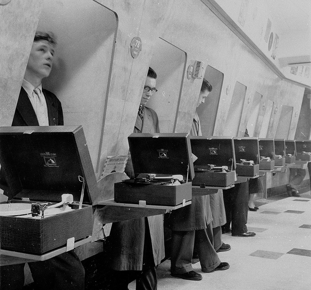 Customers using listening booths 1950s HMV